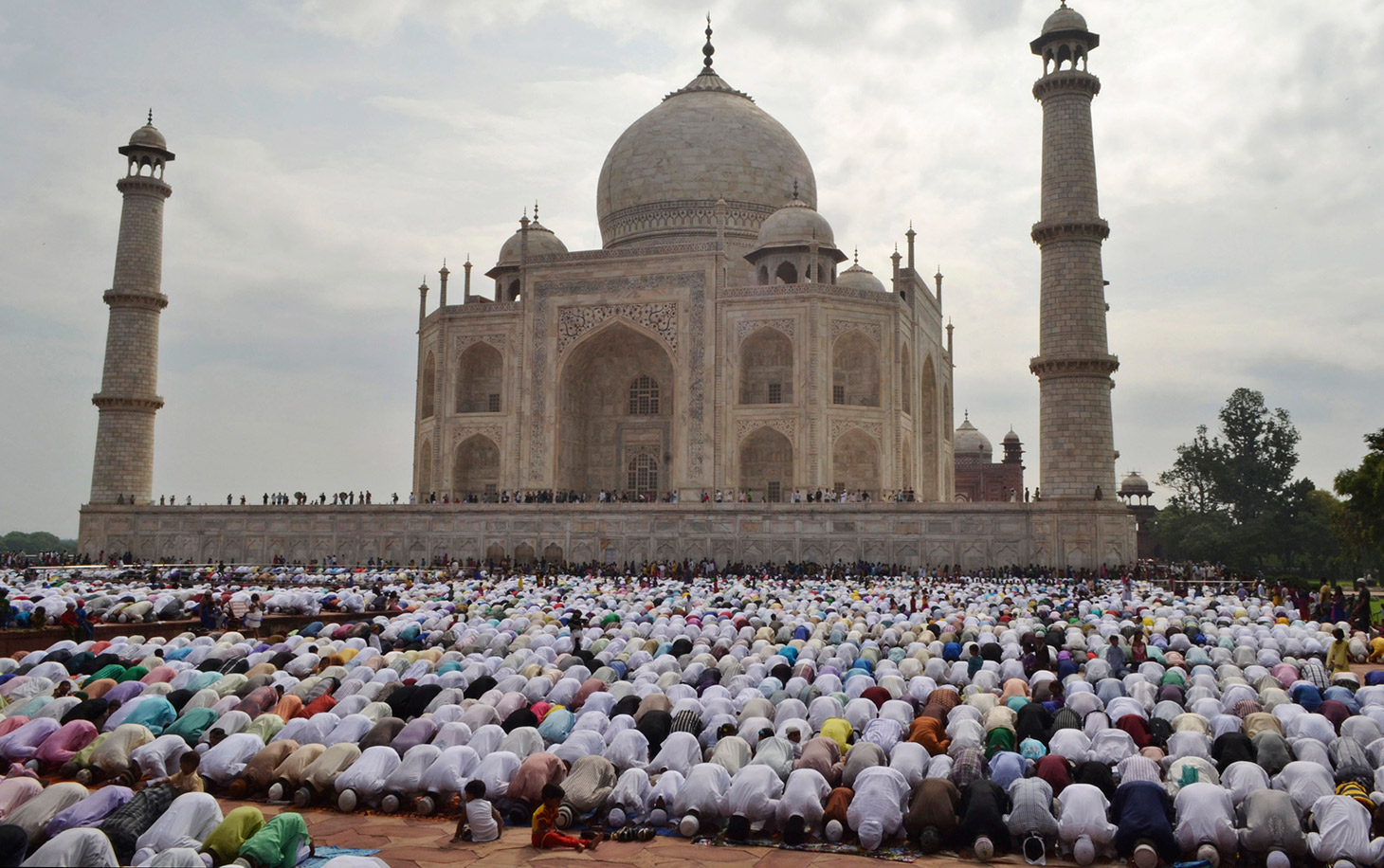 Indian Muslims offer prayers at a mosque in the premises of the Taj Mahal in Agra, India, Tuesday, July 29, 2014. Millions of Muslims across the world are celebrating the Eid al-Fitr holiday, which marks the end of the month-long fast of Ramadan. (AP Photo/Pawan Sharma)